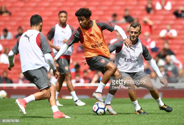 Reiss Nelson and Jack Wilshere of Arsenal during the Arsenal Training Session at Emirates Stadium on August 3 2017 in London England
