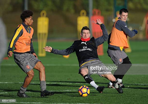 Reiss Nelson and Laurent Koscielny of Arsenal during a training session at London Colney on December 22 2016 in St Albans England