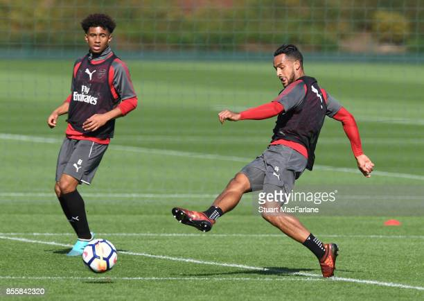 Reiss Nelson and Theo Walcott of Arsenal during a training session at London Colney on September 30 2017 in St Albans England