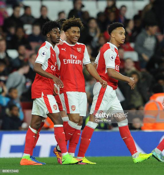 Reiss Nelson celebrates Arsenal's 2nd goal with Ainsley MaitlandNiles and Cohen Bramall during match between Arsenal and Manchester City at Emirates...