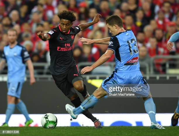 Reiss Nelson of Arsenal breaks past Brandon O'Neill of Sydney FC during the preseason friendly match between Sydney FC and Arsenal at ANZ Stadium on...