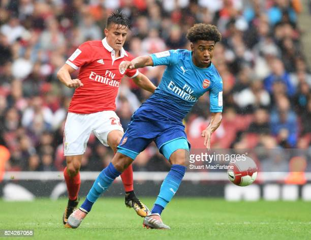 Reiss Nelson of Arsenal breaks past Franco Cervi of Benfica during the Emirates Cup match between Arsenal and SL Benfica at Emirates Stadium on July...