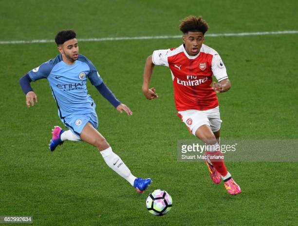Reiss Nelson of Arsenal breaks past Jadon Sancho of Man City during the Premier League 2 match between Arsenal and Manchester City at Emirates...
