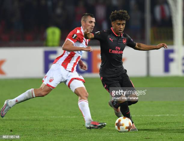 Reiss Nelson of Arsenal breaks past Nenad Krsticic of Red Star during the UEFA Europa League group H match between Crvena Zvezda and Arsenal FC at...