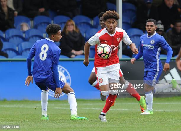 Reiss Nelson of Arsenal clips the ball past Jacob Maddox of Chelsea during the U18 Premier League match between Chelsea and Arsenal at Chelsea...