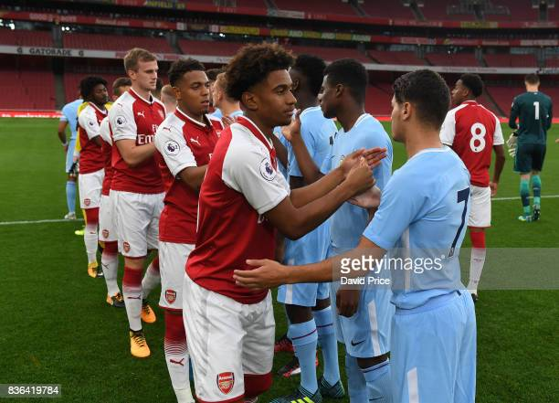 Reiss Nelson of Arsenal high fives of Brahim Diaz of Manchester City before the match between Arsenal U23 and Manchester City U23 at Emirates Stadium...