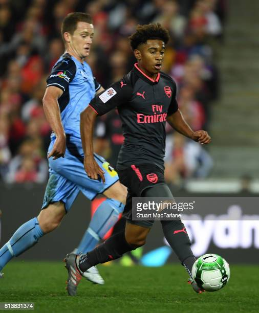 Reiss Nelson of Arsenal holds off Brandon O'Neill of Sydney FC during the preseason friendly match between Sydney FC and Arsenal at ANZ Stadium on...