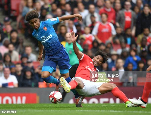 Reiss Nelson of Arsenal holds off Eliseu of Benfica during the Emirates Cup match between Arsenal and SL Benfica at Emirates Stadium on July 29 2017...