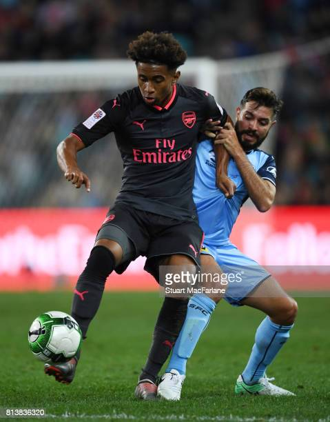 Reiss Nelson of Arsenal holds off Michael Zullo of Sydney Fcduring the preseason friendly match between Sydney FC and Arsenal at ANZ Stadium on July...