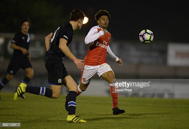 Reiss Nelson of Arsenal takes Matthew Makinson of Blackburn during the Premier League match between Arsenal and Stoke City at Meadow Park on December...