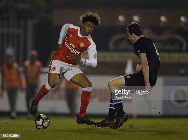Reiss Nelson of Arsenal takes on Charley Doyle of Blackburn during the Premier League match between Arsenal and Stoke City at Meadow Park on December...