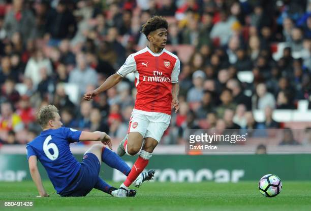 Reiss Nelson of Arsenal takes on Charlie Scott of Man Utd during the Premier League 2 match between Arsenal U23 and Manchester United U23 at Emirates...