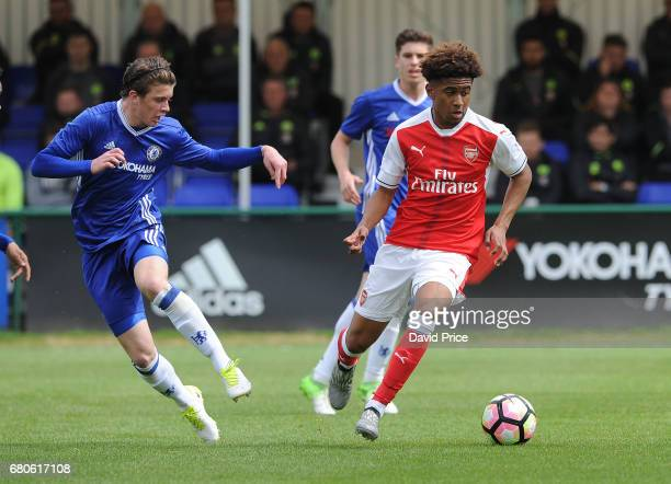 Reiss Nelson of Arsenal takes on Conor Gallagher of Chelsea during the U18 Premier League match between Chelsea and Arsenal at Chelsea Training...