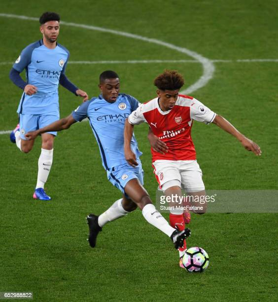Reiss Nelson of Arsenal takes on Denzeli Boadu of Man City during the Premier League 2 match between Arsenal and Manchester City at Emirates Stadium...
