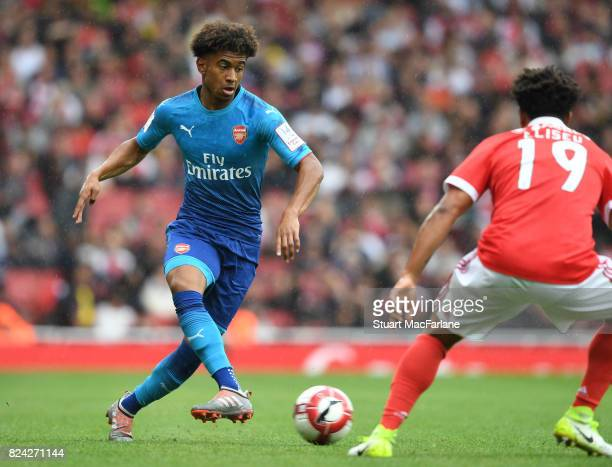Reiss Nelson of Arsenal takes on Eliseu of Benfica during the Emirates Cup match between Arsenal and SL Benfica at Emirates Stadium on July 29 2017...