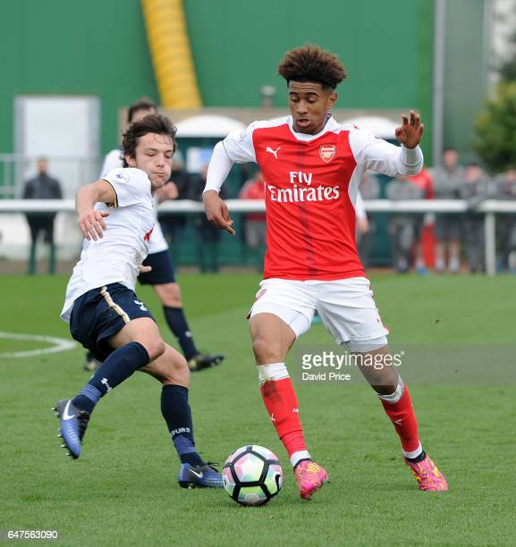 Reiss Nelson of Arsenal takes on George Marsh of Tottenham during the match between Arsenal U23 and Tottenham Hotspur U23 at London Colney on March 3...
