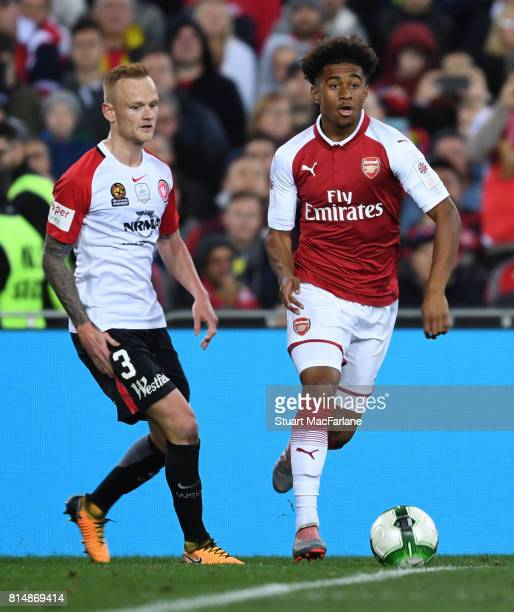 Reiss Nelson of Arsenal takes on Jack Clisby of Sydney Wanderers during the match between the Western Sydney Wanderers and Arsenal FC at ANZ Stadium...