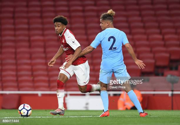 Reiss Nelson of Arsenal takes on Joel Latibeaudiere of Man City during the match between Arsenal U23 and Manchester City U23 at Emirates Stadium on...