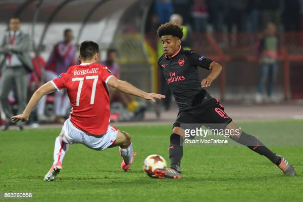 Reiss Nelson of Arsenal takes on Marko Gobeijic of Red Star during the UEFA Europa League group H match between Crvena Zvezda and Arsenal FC at Rajko...