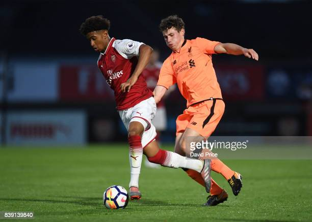 Reiss Nelson of Arsenal takes on Matthew Virtue of Liverpool during the match between Arsenal and Liverpool at Meadow Park on August 25 2017 in...