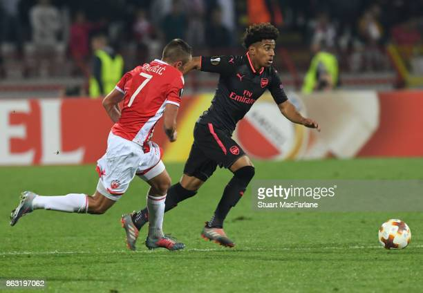 Reiss Nelson of Arsenal takes on Nenad Krsticic of Red Star during the UEFA Europa League group H match between Crvena Zvezda and Arsenal FC at Rajko...