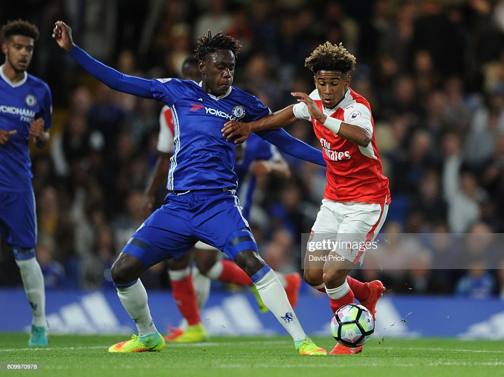 Reiss Nelson of Arsenal takes on Trevoh Chalobah of Chelsea during the match between Chelsea U23 and Arsenal U23 at Stamford Bridge on September 23, 2016 in London, England.