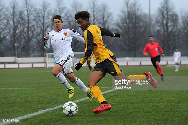 Reiss Nelson of Arsenal takes on Veriano Vogrig of Basel during the UEFA Champions League match between FC Basel and Arsenal at Leichtathletik...