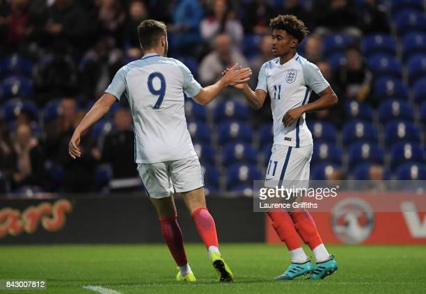 Reiss Nelson of England celebrates with teammate Ben Brereton of England after scoring his teams first goal during the U19 International match...