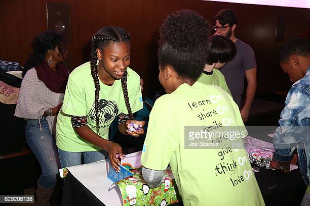 Reiya Downs and Rielle Downs attend the generationOn Hasbro and Pallas Management toy wrapping event on December 11 2016 in Studio City California