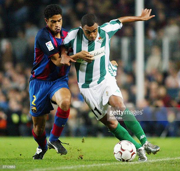 Reiziger of Barcelona and Denilson of Betis challenge for the ball during the Spanish Primera Liga match between Barcelona and Betis at the Camp Nou...