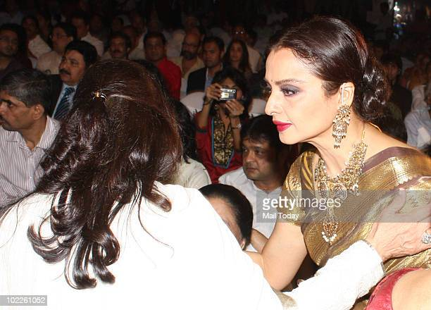 Rekha greets Jaya Bachchan at the launch of 'Chehere' a coffee table book compiled by celebrity photographer Gautam Rajadhakshya in Mumbai on June 18...
