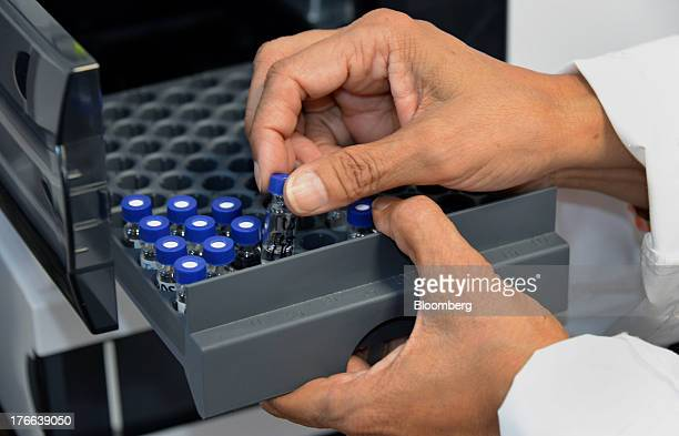 Rekha Shah director of analytical sciences at Transdermal Delivery Solutions installs test vials in a chromatographic column tester in Palm Beach...