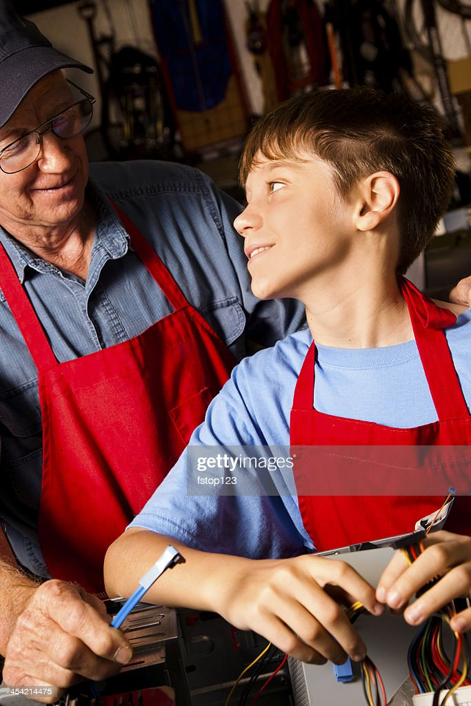 Relationships: Grandfather and grandson in workshop. : Stock Photo