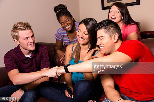 Relationships: Group 20s multi-ethnic friends hang out, watch TV together.