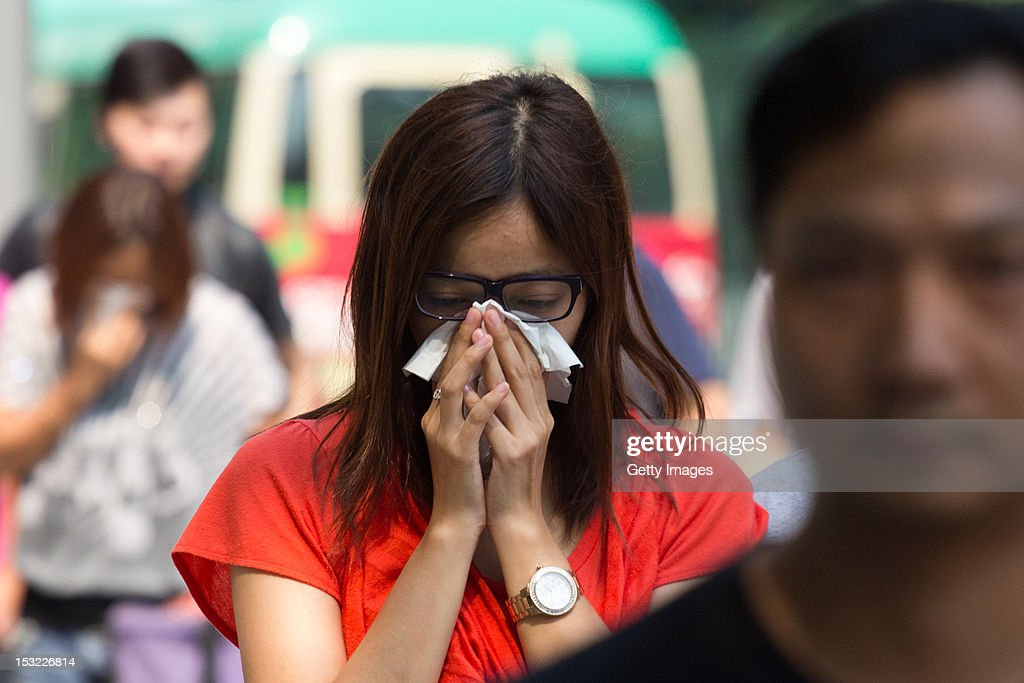 A relative cries as she leaves a public mortuary holding the bodies of those who died in a boat accident near Yung Shue Wan on Lamma Island on October 2, 2012 in Hong Kong. Twenty-five passengers were killed and several others were injured when a Hong Kong Electric ferry, carrying 124 people, collided with a tug boat off the coast of Hong Kong late on Monday.