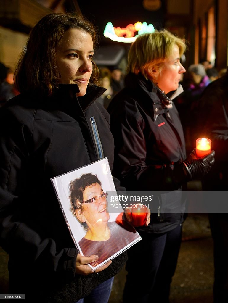 A relative holds a picture of one of the woman killed during a march on January, 5, 2013 in memory of the victims of a shooting in the village of Daillon. A gunman with psychiatric and drug problems killed three women and wounded two men on January 3, 2013 in a shooting spree in the tiny village where he lived in the mountains of southern Switzerland. Police shot and wounded the suspect after he threatened them with a gun following the attack in Daillon that raised fresh questions about the country's liberal gun ownership laws.