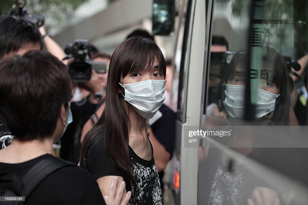 A relative (C) leaves the Kwai Chung public mortuary after identifying a victim of a boat collision in Hong Kong on October 3, 2012, two days after a ferry collided with a pleasure boat killing at least 38 people a short distance from Lamma island. More than 120 passengers and crew were on the Hong Kong Electric company's Lamma IV to watch a huge National Day fireworks display in Victoria Harbour when the accident occurred just off Lamma, an island to the southwest of Hong Kong.