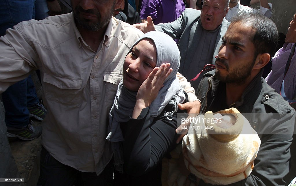 A relative mourns during the funeral of Haitham Al-Meshal in Gaza City, on April 30, 2013. An Israeli air strike on Gaza City killed one person Palestinian officials said, with Israel saying it targeted a militant involved in a rocket attack on Eilat on April 17.