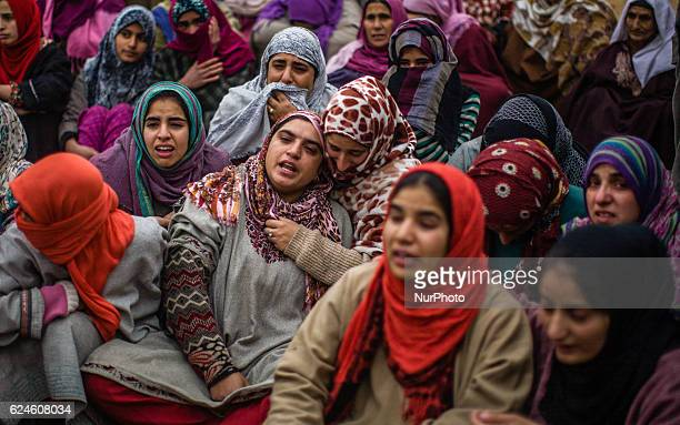 A relative mourns on seeing the body of Rayees Ahmad a militant who was killed in a gun battle with the Indian government forces during his funeral...