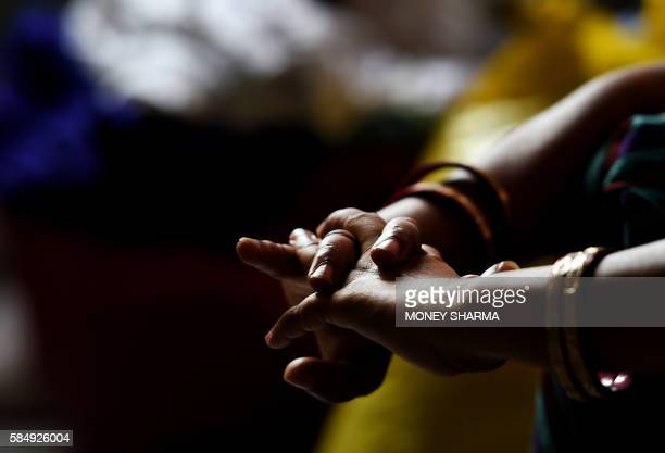 A relative of a 16 yearold Indian girl who was allegedly raped before she was murdered sits in New Delhi on August 1 2016 A 16yearold girl was...