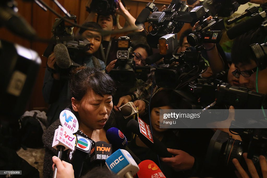 A relative of a Chinese passenger onboard Malaysia Airlines flight MH370 answer media question about the pensions inside relative area at Lido Hotel on March 11, 2014 in Beijing, China. Officials have expanded the searh area for missing Malaysia Airlines flight MH370 to include more of the Gulf of Thailand between Malayisa and Vietnam and land along the Malay Pensinusula. The flight carrying 239 passengers from Kuala Lumpur to Thailand was reported missing on the morning of March 8 after the crew failed to check in as scheduled. Relatives of the missing passengers have been advised to prepare for the worst as authorities focus on two passengers on board travelling with stolen passports.