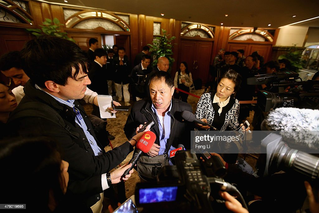 A relative of a Chinese passenger onboard Malaysia Airlines flight MH370 answer media question at Lido Hotel on March 17, 2014 in Beijing, China. The search area for Malaysian Airlines flight MH370 has increased again to include both land and water from Kazakhstan to the southern Indian Ocean following reports the airliner flew for seven hours after last contact. The missing aircraft disappeared one week ago carrying 227 passengers and 12 crew on route from Kuala Lumpur to Beijing. All passengers and crew are currently under investigation and 22 countries are involved in the search.