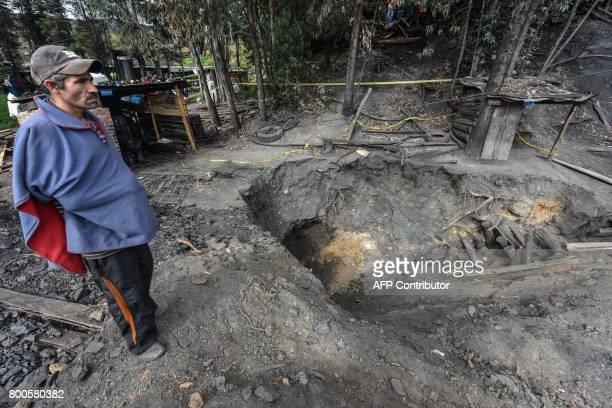A relative of a missing miner waits during search operations after an explosion at the El Cerezo illegal coal mine killed at least eight people in...