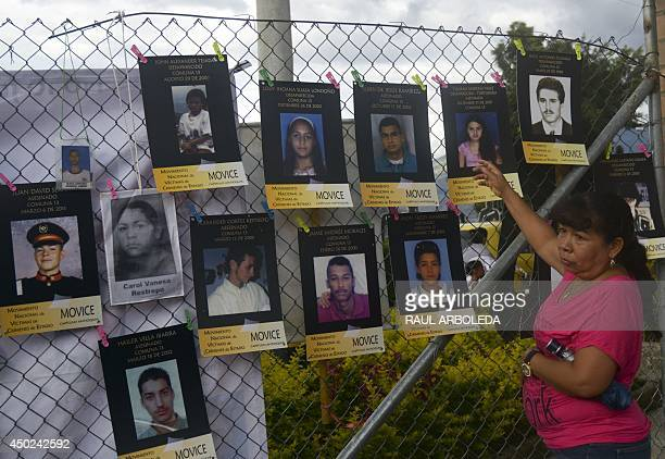 A relative of a missing person stands next to pictures of missing people at 'La Escombrera' a dumping ground for construction materials at the...