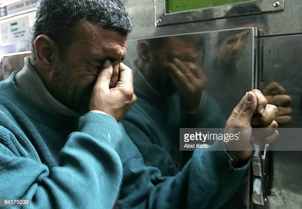 A relative of a Palestinian victim cries at the morgue in the AlShifa hospital on January 5 2009 in Gaza City Gaza Israel is intensifying its...