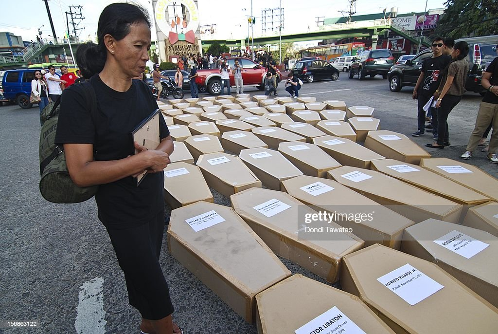 A relative of a slain journalist looks for the name of her loved one during the Remembrance Day Rally commemorating the 34 journalists massacred by paramilitary forces exactly three years ago on November 23, 2012 in Manila, Philippines. The slain journalists were part of a convoy traveling with the wife of a local politician who was going to file her husband's certificate of candidacy. The Maguindanao massacre of Nov. 23, 2009, left 58 people dead, the highest number of journalists killed in a single incident anywhere in the world.