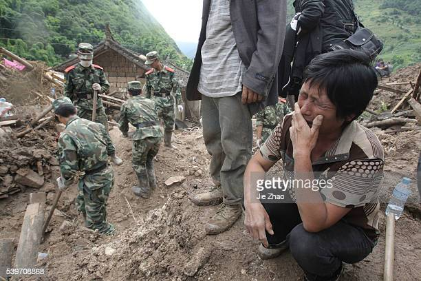 A relative of a victim during a mudslide gestures at Wama Village of Baoshan Yunnan Province September 3 2010 Chinese rescuers on Friday searched a...