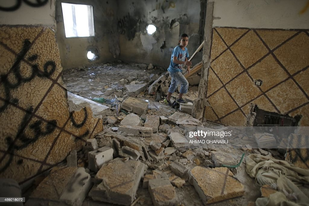 A relative of Abdelrahman Shaludi a Palestinian who killed two Israelis with his car last month walks inside his family home after it was razed by...