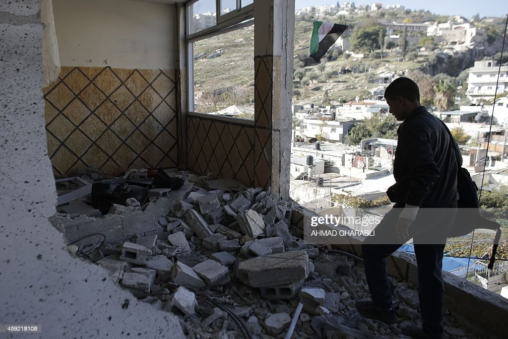 A relative of Abdelrahman Shaludi a Palestinian who killed two Israelis with his car last month stands at his family home after it was razed by...