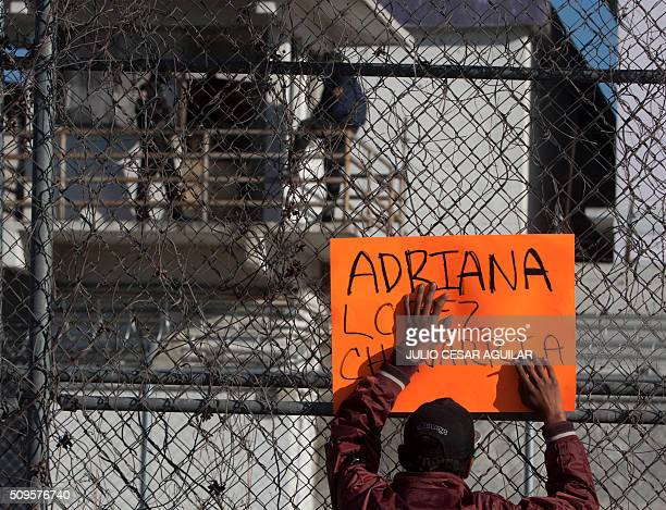 A relative of an inmate waits outside the Topo Chico prison in the northern city of Monterrey in Mexico where according to Nuevo Leon State governor...